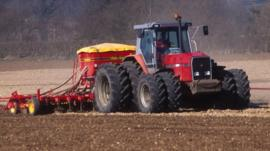 A tractor ploughing a field