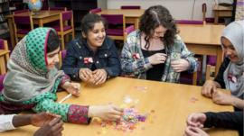 Malala and the School Reporters made some loom bands together