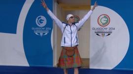 Scotland's Daniel Wallace arrives poolside wearing a kilt