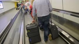 Passengers with luggage at Gatwick Airport