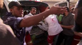 An ambulance brings wounded Palestinians to a Rafah hospital, 2 August 2014