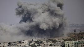 Smoke covers the skyline of Gaza