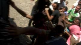Yazidis reaching out to aid flight