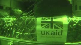 Infra red shot of pallet of goods labelled 'UK aid'