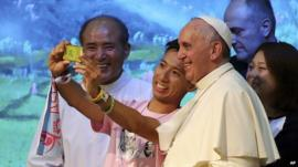 Pope Francis poses for a selfie