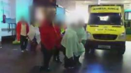 Still from video footage showing the moment the stowaways emerged from the container