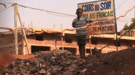 A child on a rubbish tip in Mali