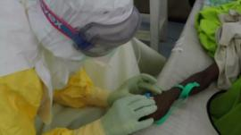 Health worker treating Ebola victim