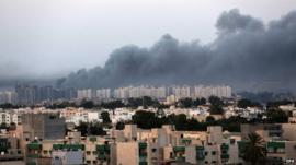 Smoke fills the sky over Tripoli after fighting between militias of Libya Fajr (Dawn of Libya) and Karama (Dignity) in Tripoli, Libya, 23 August 2014