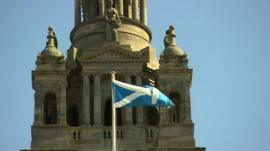 Scottish flag in front of building