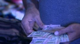 A man counting Rupees