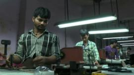 Workers in a shoe factory