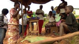 Women in Sierra Leone teaching villagers about Ebola