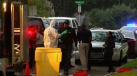Emergency teams outside Ebola victim's home