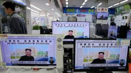 A man walks past an electronic shop in Seoul, South Korea, where TV monitors show images of North Korean leader Kim Jong-un, 14 October 2014
