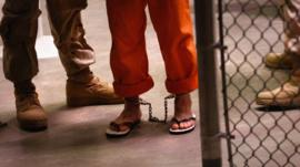 Prisoner with feet in chains