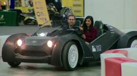 Samira Hussain test-driving Local Motors' 3D-printed Strati