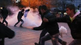 Protesters react to tear gas