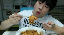 Person eating Noodles in South Korea