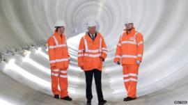 Prince Charles (middle) standing in Thames Water's Lee Tunnel, 75km under Stratford, East London