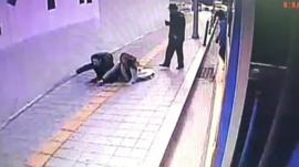 The couple falling into the sinkhole
