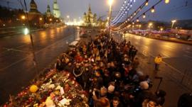 People gather at the site where Boris Nemtsov was recently killed, in central Moscow