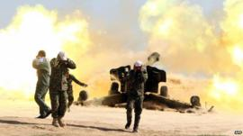 Artillery canon is fired in the village of Awaynat near Tikrit - 28 February 2015
