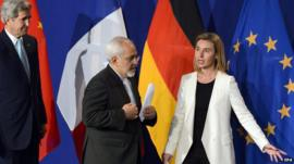 US Secretary of State John Kerry, Iranian FM Mohammad Javad Zarif and EU foreign policy chief Federica Mogherini arriving for news conference after Iran nuclear talks in Lausanne