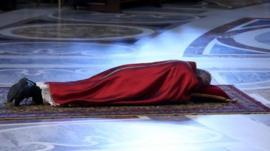 Pope Francis lies in prayer