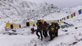 An injured person being carried by rescue team