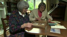 Sisters Pat Davies and Jean Argles looking at archive photos