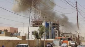 Smoke rising after bomb attack in Ramadi, 15 May 2015