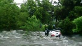 Car floating in river
