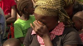 A young girl in Sierra Leone mourns the death of her parents from Ebola