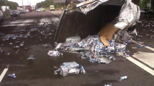 'Lager cans spilled across M6' from the web at 'http://ichef.bbci.co.uk/news/304/cpsprodpb/041E/production/_86645010_lagercans2.jpg'