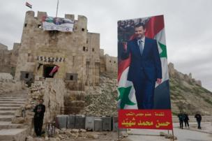 The citadel, decorated with a flag of President Assad and with a large poster of the Syrian ruler outside