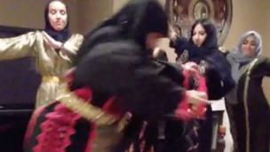 'People dressed up as arab grandmas dancing' from the web at 'http://ichef.bbci.co.uk/news/304/cpsprodpb/1360B/production/_86617397_screenshot2015-11-10at17.32.53.png'
