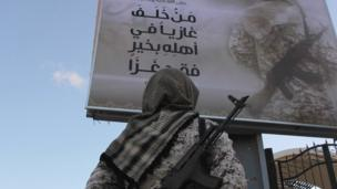 'IS image allegedly showing IS fighter in Sirte' from the web at 'http://ichef.bbci.co.uk/news/304/cpsprodpb/14DF9/production/_88079458_poster.png'