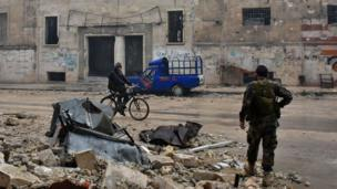 Syrian pro-government forces in Aleppo's newly captured Al-Kalasseh neighbourhood in the eastern part of the war torn city, 13 December 2016