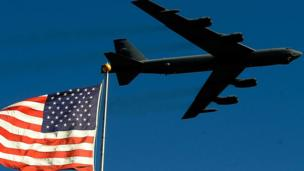 'B-52 bomber and US flag' from the web at 'http://ichef.bbci.co.uk/news/304/cpsprodpb/28FF/production/_87159401_11_12_weeklyroundupindex.jpg'