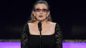 Carrie Fisher presents the life achievement award at the 21st annual Screen Actors Guild Awards at the Shrine Auditorium in Los Angeles. Jan 25, 2015