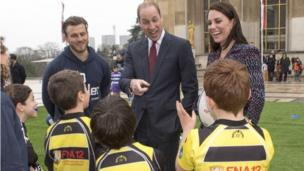 Prince William talking to young rugby players