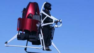 'Man operating Martin Aircraft jetpack' from the web at 'http://ichef.bbci.co.uk/news/304/cpsprodpb/68CF/production/_86613862_jetpack-2.jpg'