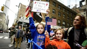 'Children thank veterans' from the web at 'http://ichef.bbci.co.uk/news/304/cpsprodpb/77F0/production/_86640703_030075380.jpg'