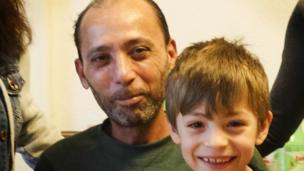 'Malek Souda and his son' from the web at 'http://ichef.bbci.co.uk/news/304/cpsprodpb/7C0C/production/_87165713_malek976.jpg'