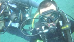 'Srin Madipalli scuba diving in Bali' from the web at 'http://ichef.bbci.co.uk/news/304/cpsprodpb/92A8/production/_86644573_bali-diving.jpg'