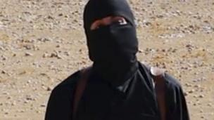 'Mohammed Emwazi - shown with a mask' from the web at 'http://ichef.bbci.co.uk/news/304/cpsprodpb/A3BE/production/_86681914_hi026072409-1.jpg'