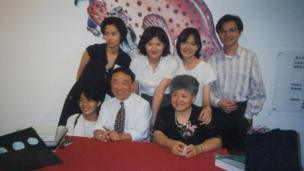 Alfonso Wong with his wife and fans in this photo dated in 1995