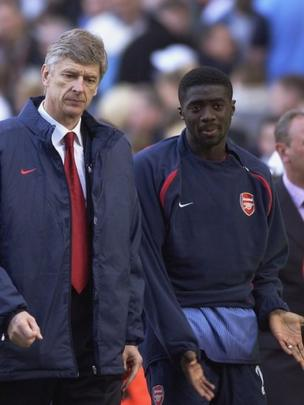 Meneja wa Arsenal Arsene Wenger na Kolo Toure