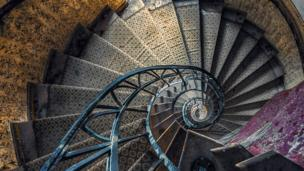 'Abandoned spiral staircase' from the web at 'http://ichef.bbci.co.uk/news/304/cpsprodpb/DA16/production/_86603855_abandoned-spiral-promo.jpg'